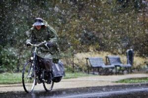 Cyclist in snow shower