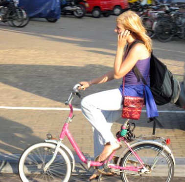 Lady cycling with mobile phone