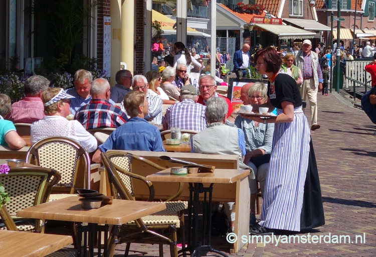 Outdoor cafe, serviced by lady in Volendam costume